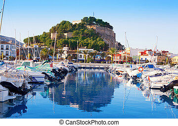 Denia mediterranean port village with castle mountain and...
