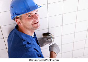Closeup of an electrician at work