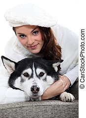 young woman cudling her dog