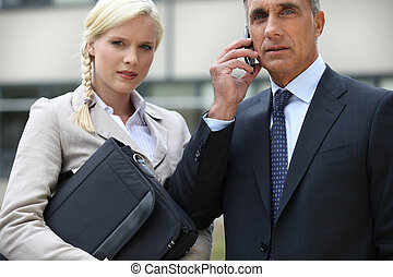 Young businesswoman and director looking worried