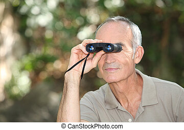 Man using a pair of binoculars