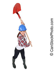 Woman holding spade over head