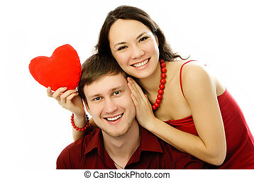 happy couple with a heart-shaped pillow - happy couple...
