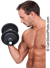 bare-chested and muscular man doing fitness with dumbbell