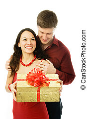 young man gives a present to his wife