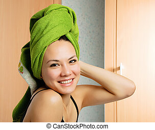 beautiful woman with a towel on her head - beautiful young...