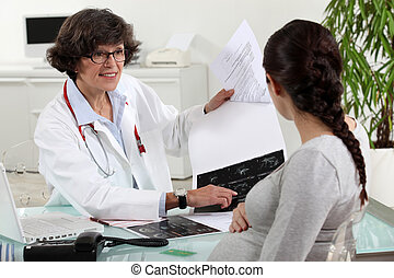 pregnant woman visiting her doctor
