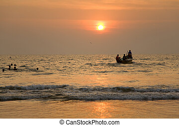 indian boat at sunset 3 - GOA, INDIA - 19 NOV 2011: indian...