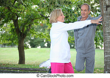 Middle-aged couple jogging