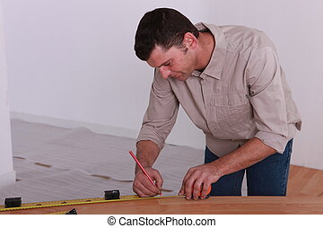 woodworker taking measurements