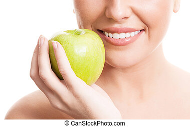 woman with an apple - closeup of the face, hands and healthy...