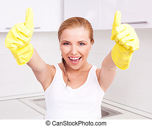 housewife with thumbs up - beautiful happy young housewife...