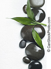 Spa stones with bamboo on white background