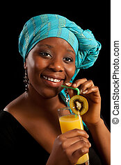 Drinking juice - Young African lady drinking orange juice...