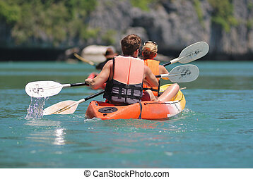 kayaking - ocean kayaking backward view of traveller
