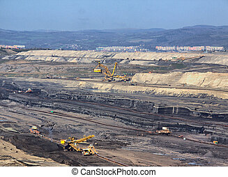 Strip coal mine with machine