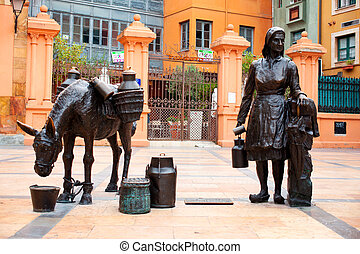 Statue in Oviedo - Statue of a donkey and a milkmaid with...