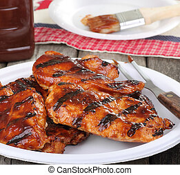 Barbeque Chicken Meal - Barbeque chicken breast on a paper...
