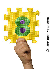 Children hand holding the number Eight. White isolated number