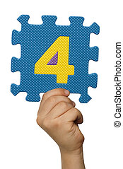 Children hand holding the number Four. White isolated number