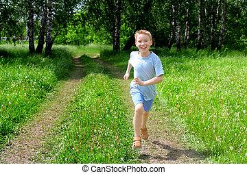 boy running - happy boy running in the summer forest