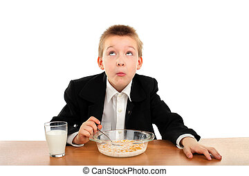 schoolboy eats - schoolboy eating corn flakes isolated on...