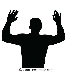 Surrendering - Man surrendering with both hands raised in...