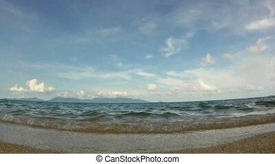 Ocean waves on tropical sand beach