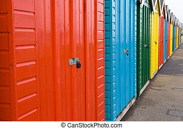 Row of colourful beach huts, Bournemouth, England