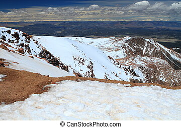 Snowy slopes of Pikes Peak Mountain and vistas in Colorado,...