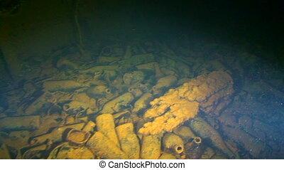 Wreck Diving, Truk Lagoon - Bottles littering the hull of...