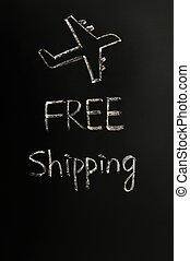 Free shipping concept written in chalk on a blackboard
