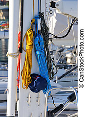 Colorful ropes hanging on yacht mas