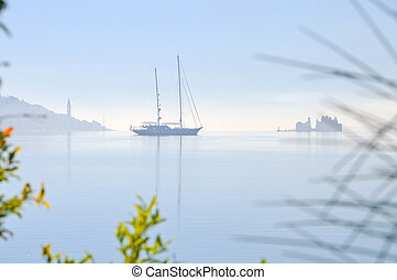 Sailing boat in the misty morning