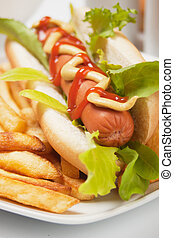 Hot dog with lettuce and french fries