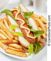 Hot dog with lettuce and french fries - Hot dog with...