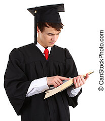 Graduate looking at a book