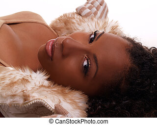 Reclining sultry portrait attractive African American woman...