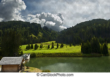 picture of the small alpine lake of the Italian Dolomites