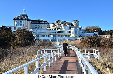 Winter Board Walk - A lone woman walking on a mid winter...