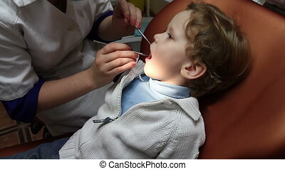 Pediatric Dentistry - Brave kid on the reception at the...