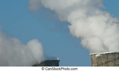 Blye Sky and Exhaust Smoke - Cooling Towers at an...