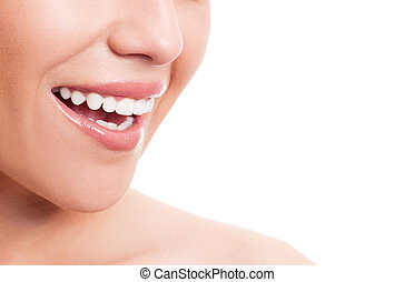 healthy teeth - closeup of the face of a young woman with...