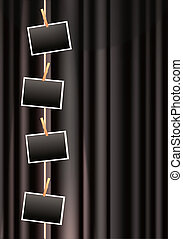 photo frames on a black curtain