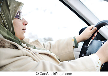 Muslim Arabic woman driving car
