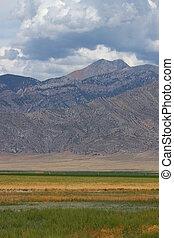 Mountains Beyond Idaho Farmland - Mountains rise tall beyond...