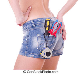 Beautiful female worker with tools in back pocket on shorts...