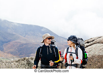 Man and woman hiking in mountains - Couple hiking in...
