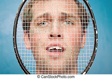 Portrait of young man - portrait of a man in a tennis net...