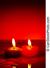 Two burning heart shaped candles - Two burning heart shaped...
